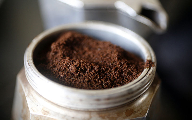 Put the ground coffee into the moka pot's filtering basket.