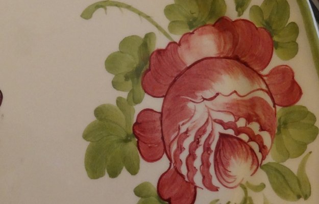 Detail of the handpainted rose, a classical 18th century motif