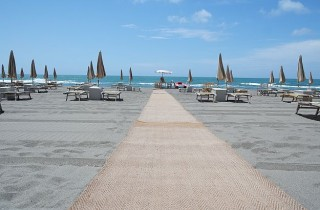 Within walking distance from our Piccola or Duna Grande villas.