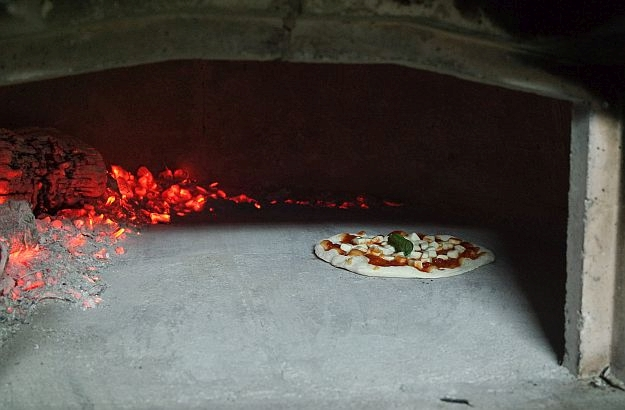A pizza is not a pizza if it hasn't been baked in a forno al legna.